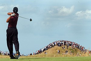 Tiger Woods of the United States tees-off on the 5th hole during the final round of the British Open golf championship at Royal St. George's golf course in Sandwich, England, Sunday, July 20, 2003.