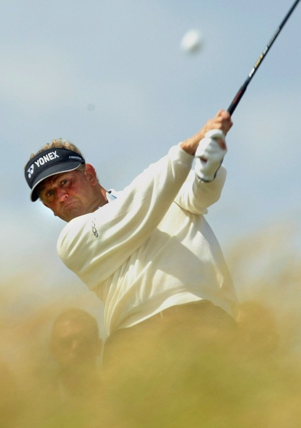 Scotland's Colin Montgomerie plays from the 4th tee on the final day of the British Open golf championship at Royal Troon golf course in Troon, Scotland Sunday July 18, 2004.