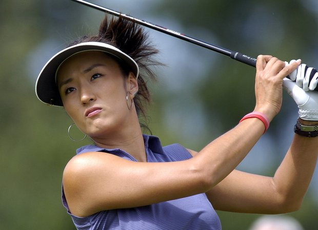 Grace Park of Korea tees off at the first hole, during the final day of the Evian Masters women's golf tournament in Evian, eastern France, Saturday, July 24, 2004.
