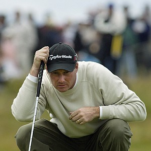 Todd Hamilton of the United States lines up a putt on the 3rd hole on the final day of the British Open golf championship at Royal Troon golf course in Troon, Scotland Sunday July 18, 2004.