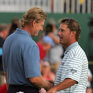 South Africa's Ernie Els, left, and Chris DiMarco from the United States, shake hands on the 18th green after their final round at the British Open Golf Championship at the Royal Liverpool Golf Course in Hoylake, England Sunday July 23, 2006. DiMarco finished in second place in the championships and Els took third 3rd place.