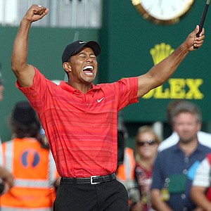 Tiger Woods of the United States celebrates after winning the British Open Golf Championship at the Royal Liverpool Golf Course in Hoylake, England Sunday July 23, 2006.