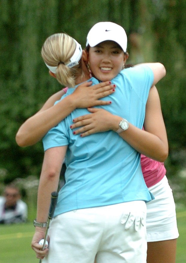 Karrie Webb of Australia, left, is congratulated by Michelle Wie from the U.S.after winning the Evian Masters women's golf tournament in Evian, eastern France, Saturday, July 29, 2006.