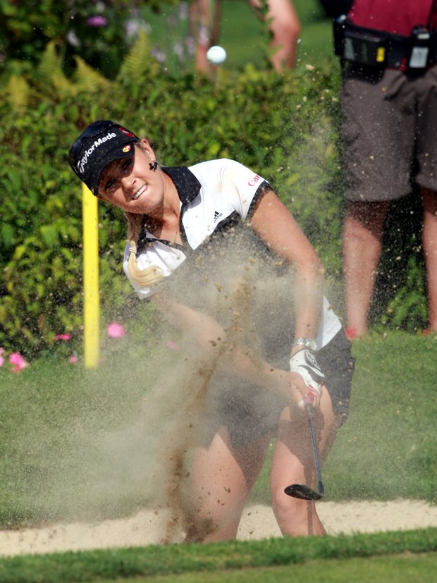 Natalie Gulbis of the US chips out of a bunker at the 18th hole during the Evian Masters women's golf tournament in Evian, eastern France Sunday, July 29, 2007. Gulbis won the Ev ian Masters 2007.