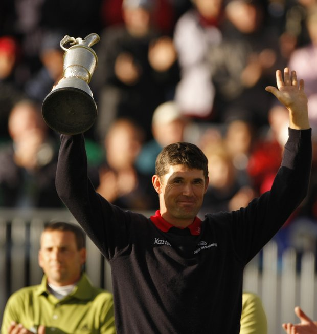 Ireland's Padraig Harrington, right, holds the trophy after winning the British Open Golf Championship as runner-up Sergio Garcia of Spain looks on at Carnoustie, Scotland, Sunday July 22, 2007.