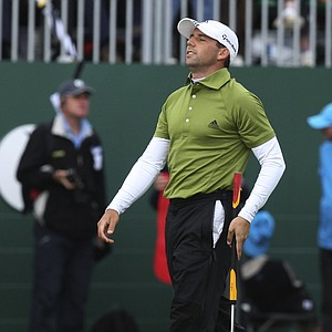 Spain's Sergio Garcia, reacts after missing a putt on the 18th green which would have won him the championship during the final round of the British Open Golf Championship at Carnoustie, Scotland, Sunday July 22, 2007.