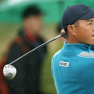 Japan's Toru Taniguchi plays from the 16th tee during the final round of the British Open Golf Championship at Carnoustie, Scotland, Sunday July 22, 2007.