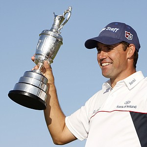 In this July 20, 2008, file photo, Padraig Harrington of Ireland, poses with the Claret Jug trophy after winning the British Open Golf championship, at the Royal Birkdale golf course, Southport, England. Harrington has gone from a perennial runner-up to a prolific major champion, the first European to win consecutive majors in the same year, and now a chance to become the first player in more than 50 years to win the claret jug three straight times.