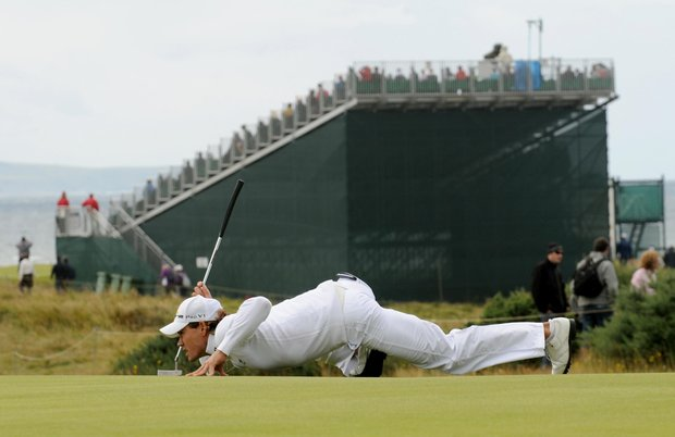 Colombia's Camilo Villegas lines up a putt during the fourth round round of the British Open Golf Championship at Turnberry Golf Club, Turnberry, Scotland Sunday July 19, 2009.