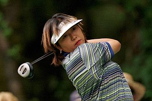 Akiko Fukushima, of Tokyo, Japan, tees off heading into the third day of U.S. Women's Open action at Pumpkin Ridge Golf Club in North Plains, Ore., Saturday, July 12, 1997.
