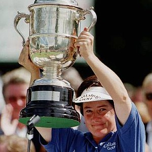 British golfer Alison Nicholas holds up the U.S. Women's Open trophy in North Plains, Ore., Sunday, July 13, 1997. Nicholas held off an emotion-packed challenge from Hall-of-Famer Nancy Lopez to capture the trophy by one stroke.