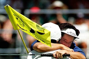 British golfer Alison Nicholas hugs her caddy Mark Fuller after winning the U.S. Women's Open in North Plains, Ore., Sunday, July 13, 1997.