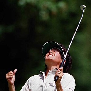 Nancy Lopez reacts after missing a birdie putt on the seventh hole at Pumpkin Ridge Golf Club during the final round of the 1997 U.S. Women's Open in North Plains, Ore. Lopez lost her bid for her first U.S. Women's Open victory to British golfer Alison Nicholas by one stroke.
