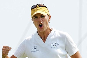 Annika Sorenstam celebrates her birdie on the 16th green in the third round of the U.S. Women's Open on Saturday, July 6, 2002, at Prairie Dunes Country Club in Hutchinson, Kan. Sorenstam shot a 1-under-par 69 and was leading the tournament by two strokes.