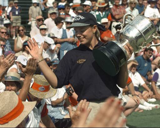 Sweden's Annika Sorenstam exchanges high-fives with the crowd after winning the 50th U.S. Women's Open at The Broadmoor CC in Colorado Springs, Colo., Sunday, July 16, 1995. Sorenstam had a 2-under-par 278 total to beat out Meg Mallon by one stroke.