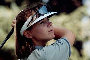Annika Sorenstam watches her tee shot on the fourth hole during the opening round of the 1995 U.S. Women's Open at the Broadmoor CC in Colorado Springs, Colo. Sorestam shot a 3-under-par 67, one shot off of the lead.