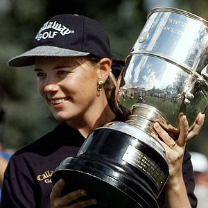 Sweden's Annika Sorenstam holds her trophy after winning the 1995 U.S. Women's Open at The Broadmoor Country Club in Colorado Springs, Colo., Sunday, July 16, 1995. It was the first U.S. tour win for the 24 year old.