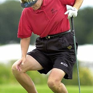 Betsy King of Reading, Pa. struggles to stand after teeing up her ball on the fifth hole during the third round at the US Women's Open Saturday July 22, 2000 in Gurnee, Ill. King injured her back on the second tee, but finished the round 10-over-par for the day.