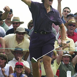 Juli Inkster celebrates after making a birdie on the 16th hole of the Prairie Dunes CC course during the final round of the U.S. Women's Open, Sunday, July 7, 2002, in Hutchinson, Kan. Inkster won the tournament with a four-under-par 276.