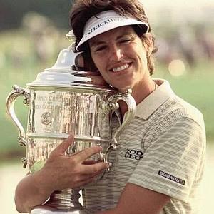 Juli Inkster hugs the 1999 U.S. Women's Open Championship trophy following her victory in West Point, Miss.