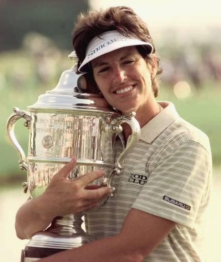 Juli Inkster hugs the 1999 U.S. Women's Open Championship trophy following her victory in West Point, Miss.