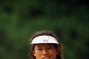 Amatuer Jenny Chuasiriporn makes a face as she looks at her ball that landed short of the green after hitting out of a bunker on the ninth hole during the playoff round of the U.S. Women's Open Monday, July 6, 1998, in Kohler, Wis.