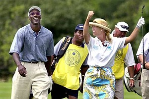 Michael Jordan enjoys a laugh with Michelle McGann during a three hole exhibition at the US Women's Open Tuesday July 18, 2000 in Libertyville, Ill. McGann and Laura Davies defeated Jordan and Nancy Lopez.