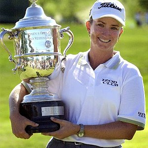 Karrie Webb, of Queensland, Australia, holds the U.S. Women's Open trophy after winning the event Sunday July 23, 2000 in Gurnee, Ill. Webb finished at 6-under 282, five strokes ahead of everyone else.