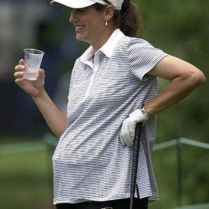 Brenda Corrie Kuehn takes a drink as she waits to hit her tee shot on the second hole at Pine Needles Lodge and GC in Southern Pines, N.C., Tuesday May 29, 2001, during practice for the U.S. Women's Open. Kuehn wore men's golf shirts and carried 25 extra pounds in the eighth month of her pregnancy. But she expected a normal golf experience for the U.S. Women's Open.
