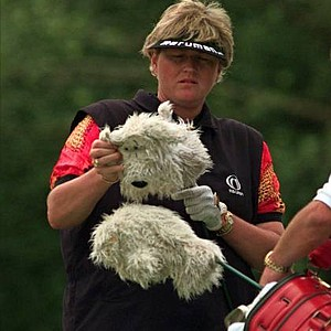 Laura Davis takes her personalized woods cover off on the eighth hole during a practice round for the Women's U.S. Open at Pupkin Ridge GC, Wednesday, July 9, 1997, in North Plains, Ore.