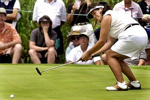 Nancy Lopez reacts as she barely misses a birdie putt on the fourth hole during the second round at the US Women's Open, Friday, July 21, 2000, in Gurnee, Ill.
