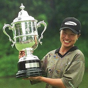Korea's Se Ri Pak holds up the U.S. Women's Open trophy following the championship Monday, July 6, 1998, in Kohler, Wis. Pak beat Amatuer Jenny Chuasiriporn on the second hole of a sudden death playoff.