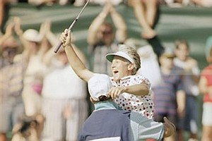 Patty Sheehan jumps into the arms of her caddie, Carl Leib, after sinking the winning putt in the 1994 U.S. Women's Open on the 18th green at Indianwood Golf and CC, in Lake Orion, Mich., July 24, 1994. Sheehan defeated Tammie Green by one stroke.