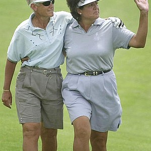 Patty Sheehan, left, puts her arm around Nancy Lopez as Lopez waves to the gallery on the 18th hole of the Prairie Dunes course during the second round of the U.S. Women's Open, Friday, July 5, 2002, in Hutchinson, Kan.