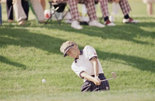 Patty Sheehan hits from the sand on the 7th green at Indianwood Golf and CC in Lake Orion, Mich., during the second round of the U.S. Women's Open, July 22, 1994.
