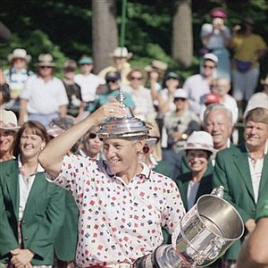 Patty Sheehan places the top of the U.S. Women's Open trophy on her head during the awards presentation, July 24, 1994, at the Indianwood Golf and CC in Lake Orion, Mich. Sheehan, who also won the Open in 1992, beat Tammie Green by one stroke.