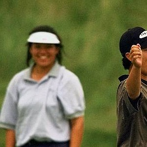 Korea's Se Ri Pak reacts, at right, while amatuer Jenny Chuasiriporn watches after making a birdie putt on the second sudden death hole during the playoff round of the U.S. Women's Open Monday, July 6, 1998, in Kohler, Wis.