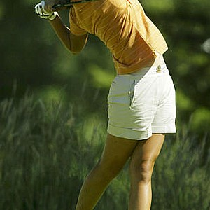 Michelle Wie, 13-years-old from Honolulu, Hawaii, watches her tee shot on 16 during the first round of the U.S. Women's Open at Pumpkin Ridge Golf Club in North Plains, Ore., Thursday, July 3, 2003.