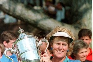 Betsy King, holds her trophy up Sunday, July 17, 1989, after winning her first U.S. Women's Open title at Lake Orion, Mich.