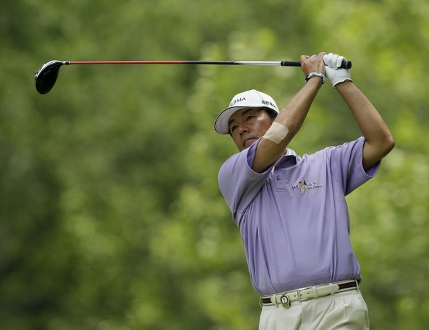 Kiyoshi Murota of Japan watches his tee shot on the second hole during the third round of the Senior PGA Championship golf tournament at Valhalla Golf Club, Saturday, May 28, 2011, in Louisville, Ky.