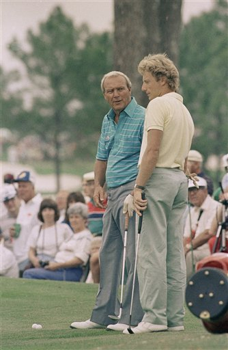 April 6, 1986 - Bernhard Langer, right, last year's Masters champion, and Arnold Palmer, left, a four-time winner, chat as they played in a practice round at the Augusta National Golf Club on Tuesday, April 9, 1986.