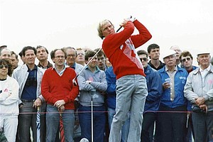 Nov. 29, 1987 - Watched by an attentive audience, defending Open Champion Greg Norman, tees off during a practice round , before the start of the Open Golf Championships, at Muirfield, Scotland, on July 15, 1987.