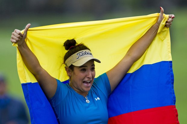Mariajo Uribe of Colombia holds up her national flag as she celebrates her HSBC LPGA Brazil Cup victory in Rio de Janeiro, Brazil, Sunday May 29, 2011. Uribe won the two-round event defeating Lindsey Wright of Australia by a stroke.