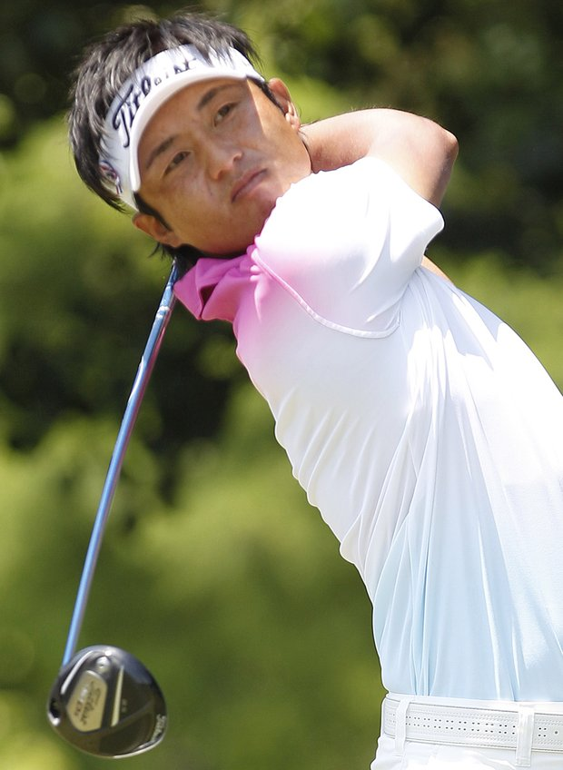 Ryuji Imada, of Japan, watches his tee shot on the first hole during the final round of the Byron Nelson Championship golf tournament in Irving, Texas, Sunday, May 29, 2011.