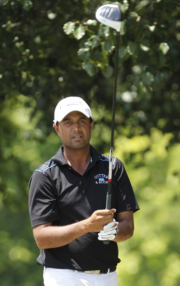Arjun Atwal of India prepares for his first hole tee-shot during the final round of the Byron Nelson Championship golf tournament in Irving, Texas, Sunday, May 29, 2011.