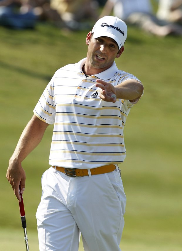 Sergio Garcia, of Spain, asks for his put line to be cleared on the 18th hole during the third round of the Byron Nelson Championship golf tournament, Saturday, May 28, 2011, in Irving, Texas. He holds sole second place with a 4-under-par and has been battling an infected left hand finger.