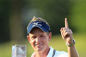 May 29, 2011 – Luke Donald holds the trophy and holds his finger in the air to show that he's the new world's number one golfer at the BMW PGA Championship 2011 - May 29, 2011.