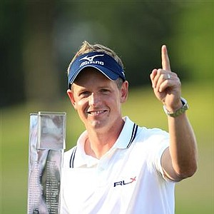 May 29, 2011 –Luke Donald holds the trophy and holds his finger in the air to show that he's the new world's number one golfer at the BMW PGA Championship 2011 - May 29, 2011.