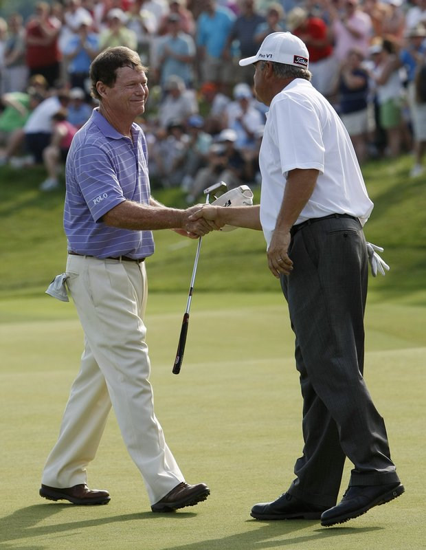 Tom Watson, left, shakes hands with David Eger after beating him in a playoff to win the Senior PGA Championship golf tournament at Valhalla Golf Club in Louisville, Ky., Sunday, May 29, 2011.