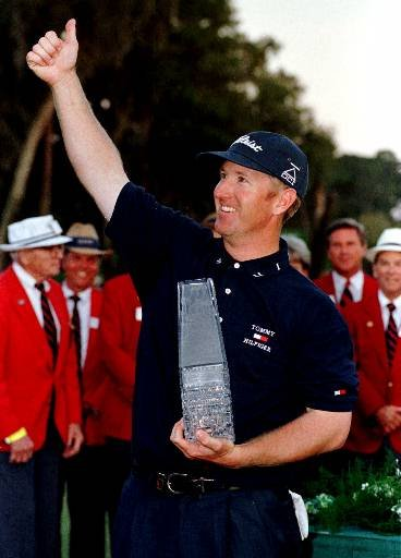 March 28, 1999 - David Duval holds the winning trophy and gives a thumbs up after winning The Players Championship in Ponte Vedra Beach, Fla., on Sunday, March 28, 1999. Duval closed with a 1-over 73 to finish at 285, the highest winning score in the Players since it moved to the TPC at Sawgrass in 1982.